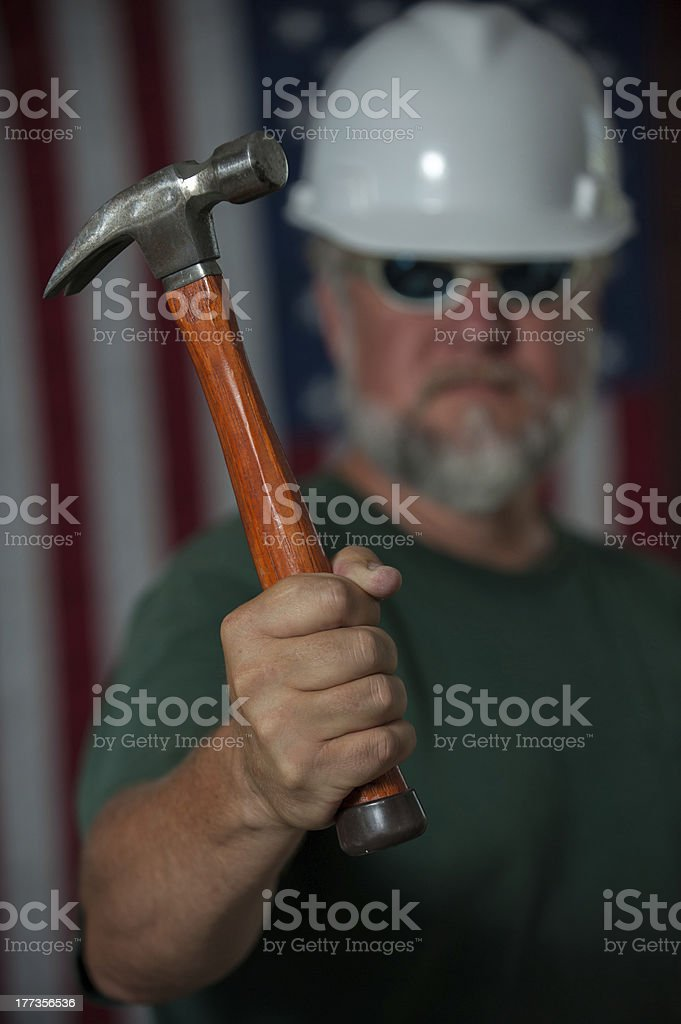 American worker holding a hammer royalty-free stock photo