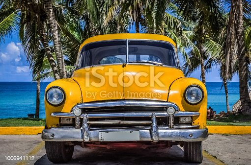 American yellow classic car parked before the beach in Varadero Cuba - Serie Cuba Reportage