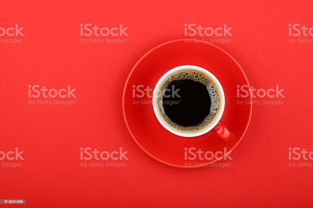 Americano coffee in full cup with saucer on red stock photo
