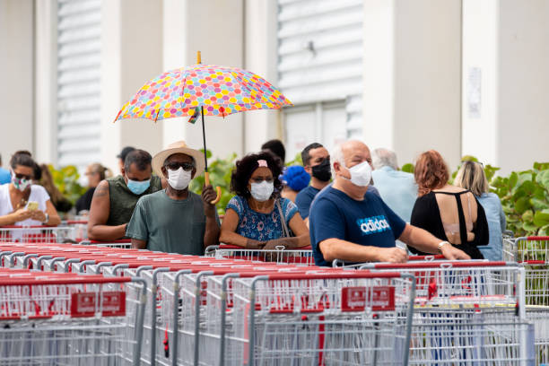 Americans wearing face masks to stop spread of Coronavirus Covid 19 pandemic