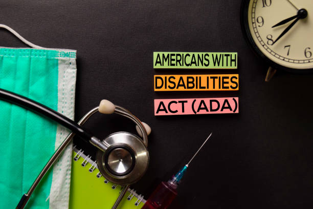 Americans with Disabilites Atc (ADA) text on top view black table with blood sample and Healthcare/medical concept. stock photo