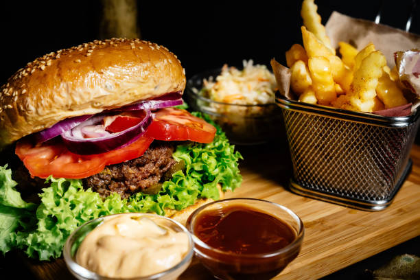 americanTasty and delicious juicy beef burger, american style food with french fries and coleslaw stock photo