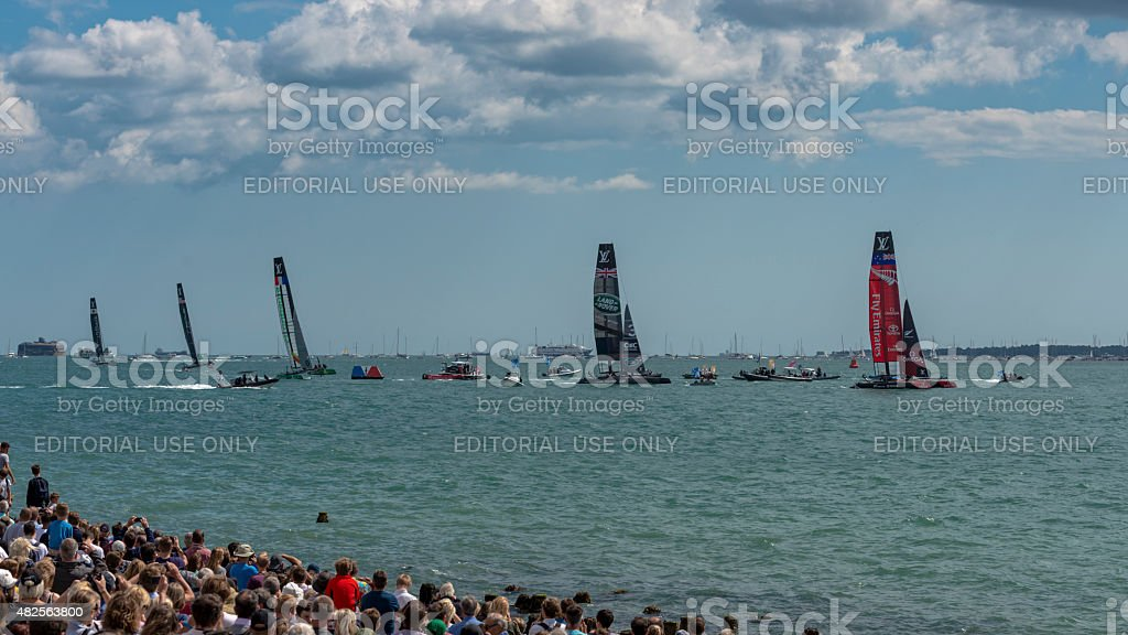 America's Cup boats sail over the finish line stock photo
