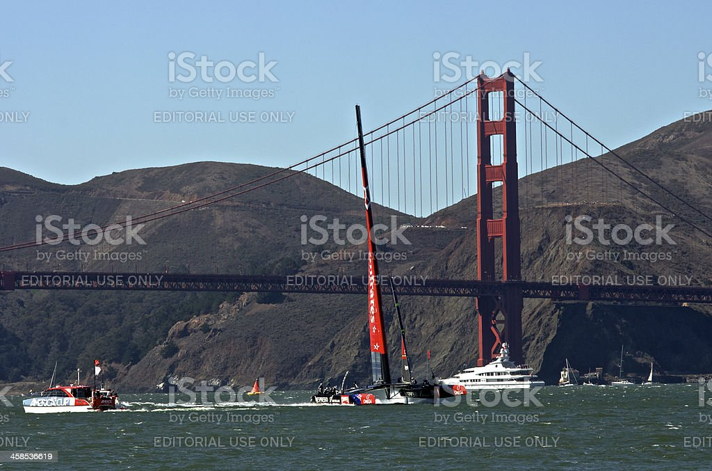 America's Cup New Zealand Racing at Golden Gate Bridge royalty-free stock photo