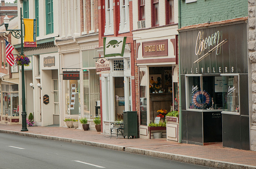 Staunton, USA - July 4, 2011: Main Street Staunton in broad daylight and at its best, carrying the legacy of the archetypal American Small Town on a 4th of July.