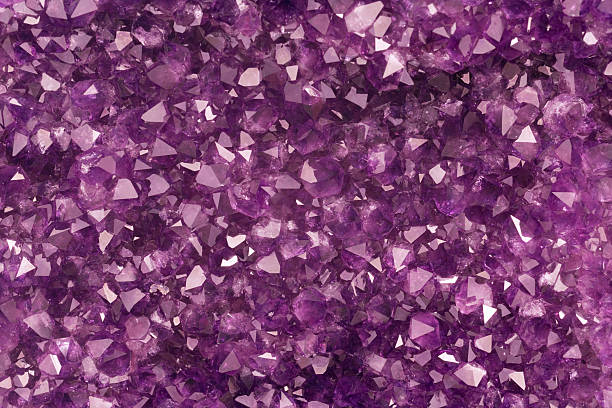 Amethyst crystal background template in purple stock photo