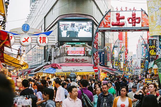 Ameyoko Street Market, Tokyo, Japan Crowded and busy Ameyoko shopping street in Tokyo, Japan asian market stock pictures, royalty-free photos & images