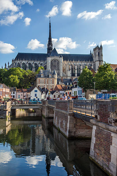 Amiens - France Amiens, France - June 1, 2012: Amiens Cathedral and the River Somme in the town of Amiens in the Picardy region of northern France. somme stock pictures, royalty-free photos & images