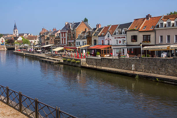 Amiens - France Amiens, France - June 1, 2012: River Somme flowing through the town of Amiens in the Picardy region of northern France. picardy stock pictures, royalty-free photos & images