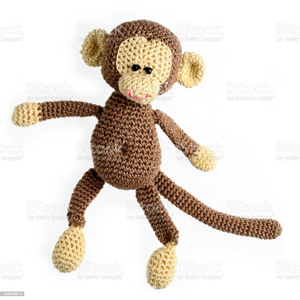 amigurumi mono punto de juguete aislado sobre fondo blanco - foto de stock