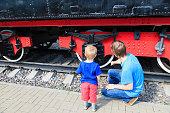 amily looking at steam train outdoors