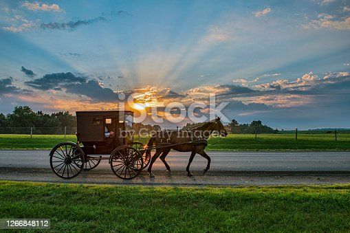 istock Amish Buggy and Sunbeams at Daybreak 1266848112