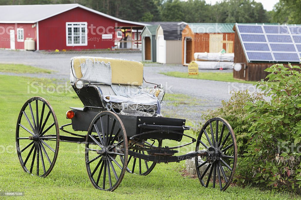 Amish Carriage Buggy with Torn Seat Covers stock photo