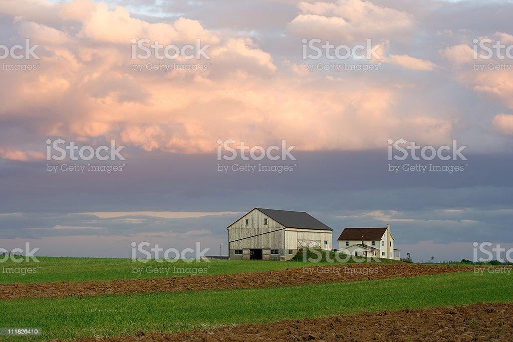 Amish Farmstead at Sunset stock photo