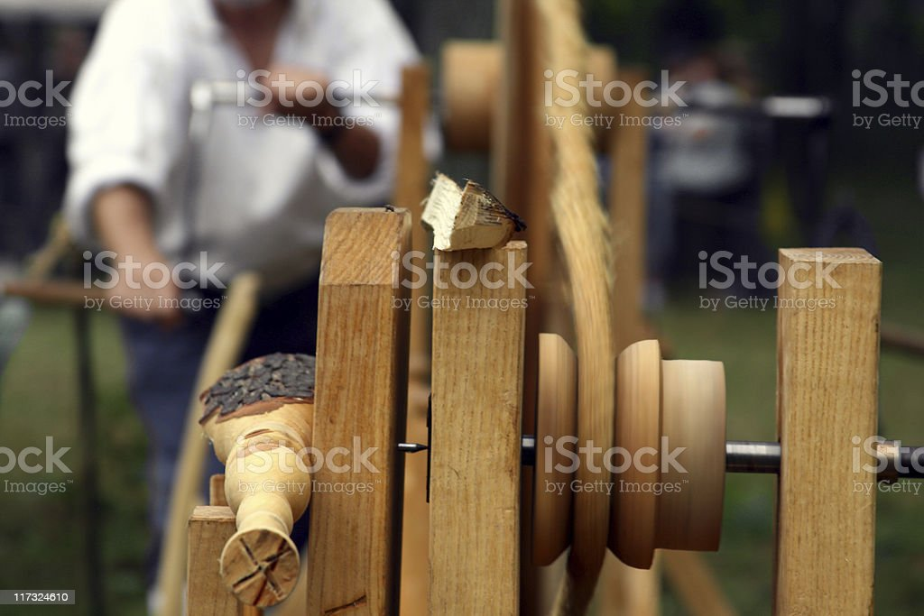 Amish man Turning Spindles: Doing Carpentry the old fashioned way stock photo