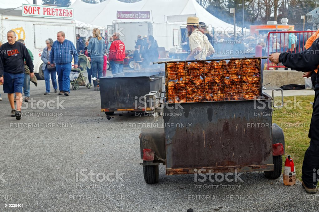 Amish Volunteers Barbecuing Chicken at the Annual Spring Sale stock photo