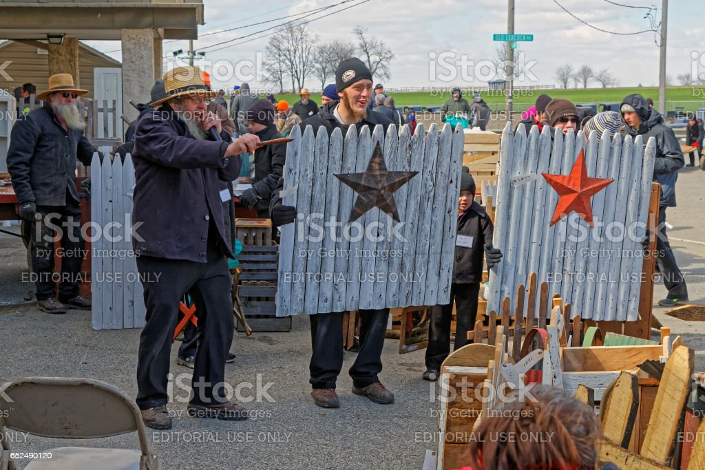 Amish Volunteers Help at the Annual Spring Auction stock photo