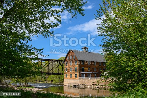 May 14, 2020, Neshanic Station, New Jersey USA - A view of the  Ammeran Mill along the Raritan River on sunny spring day.