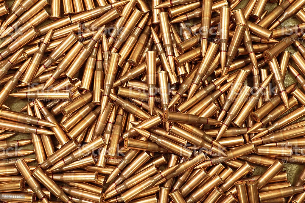 ammo to machine guns as background stock photo