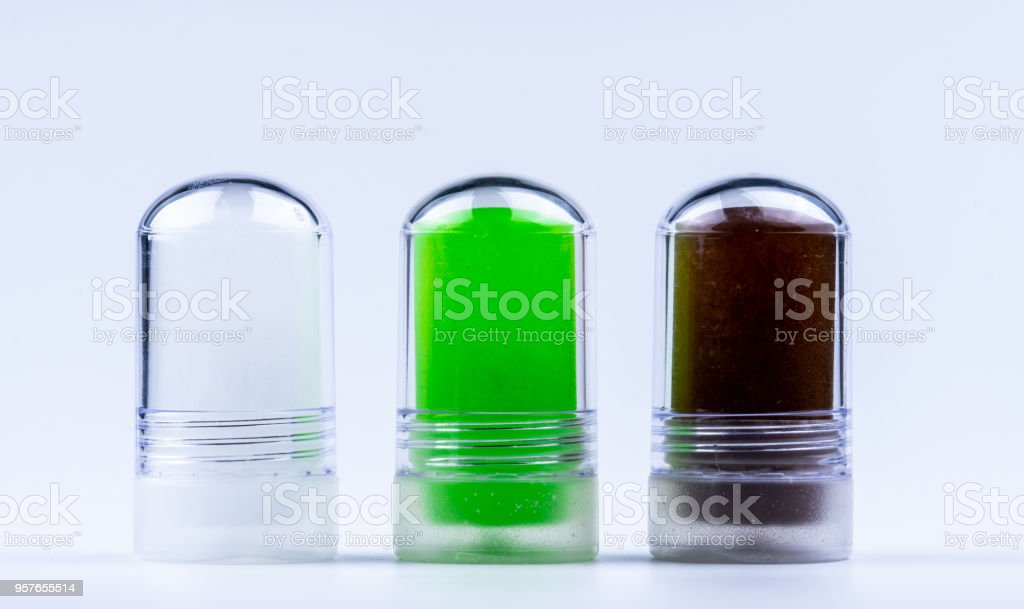 Ammonium alum with Aloe Vera extract, Lakoocha extract in deodorant stick. Green, white and brown deodorant sticks. Underarms antiperspirant products .Creative product design for added value. stock photo