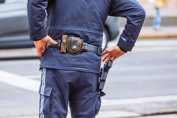 ammunition belt on policeman waist stock photo