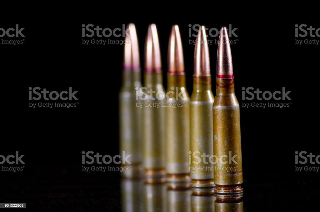Ammunition cartridges on black stock photo