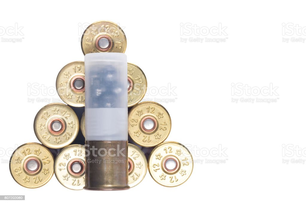 Ammunition for hunting lie in heap on white background isolated stock photo