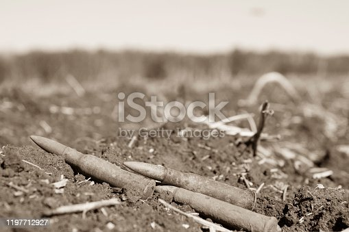 istock ammunition found during the clearance of the place of action of ISIS militants in Syria, the front and background blurred with the effect of bokeh 1197712927