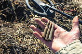 istock ammunition found during the clearance of the place of action of ISIS militants in Syria, the front and background blurred with the effect of bokeh 1197712928