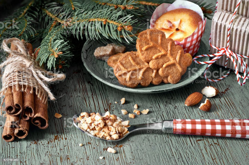 Amond cookies and lemon mini-muffin with ingredients and Christmas tree twigs stock photo