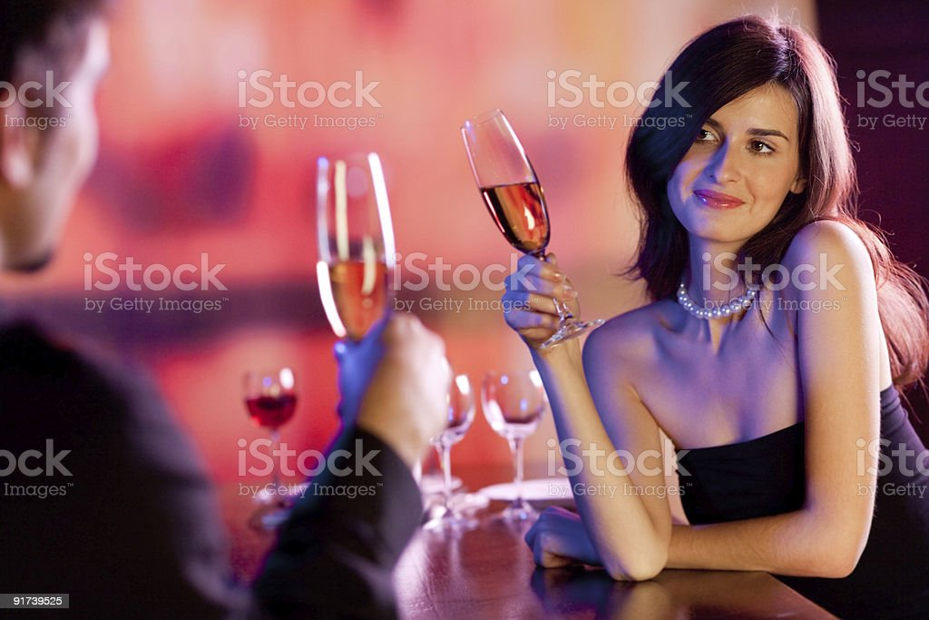 Amorous couple on a date celebrating at a restaurant stock photo