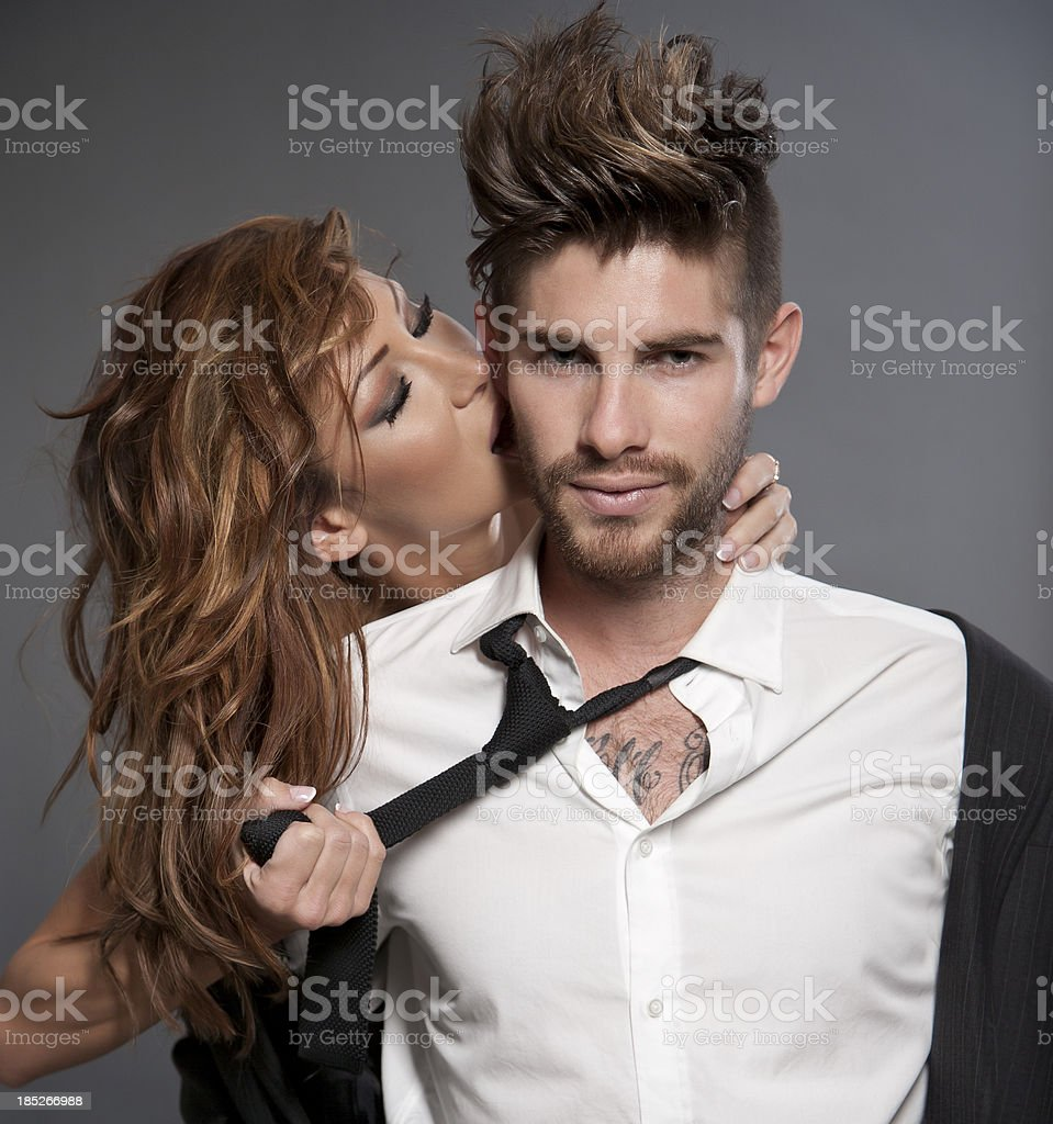 Amorous Couple on grey background stock photo