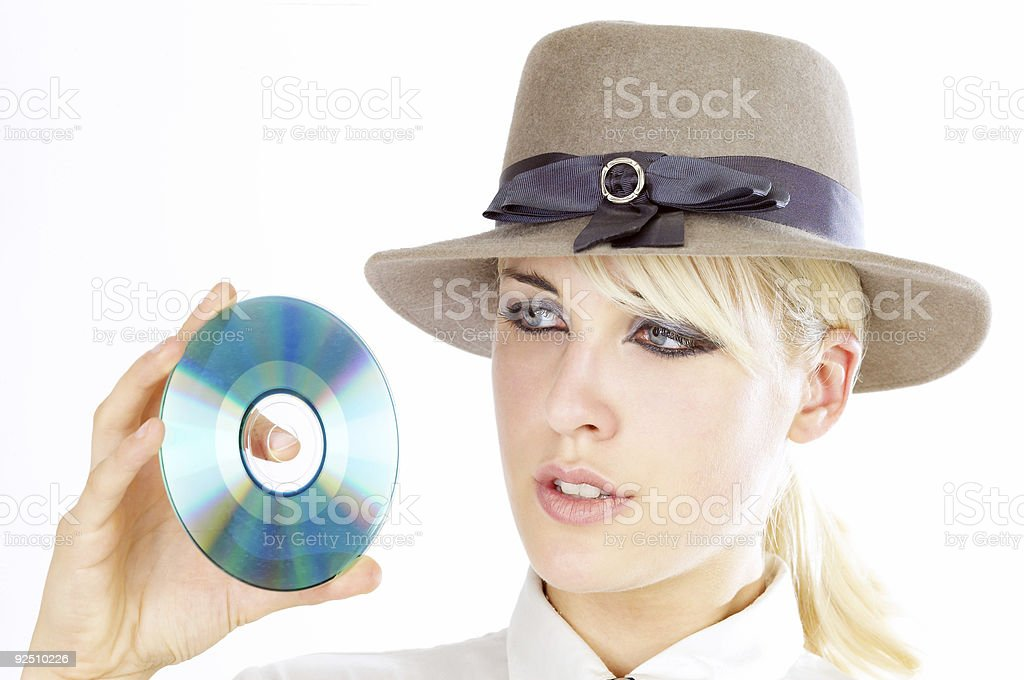 DVD & girl in hat royalty-free stock photo
