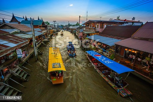 Samut Songkhram, Thailand - 24 February 2019: Amphawa Evening Market is a famous floating market and tourist attraction of Samut Songkhram province.
