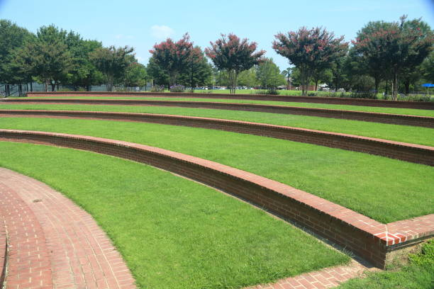 Amphitheater in local park Amphitheater Grass steps in local park amphitheater stock pictures, royalty-free photos & images