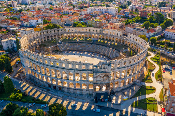 Amphitheater in Pula Amphitheater in Pula, aerial view, Pula, Croatia amphitheater stock pictures, royalty-free photos & images