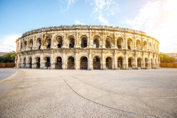 Amphitheatre in Nimes Morning view on the roman amphitheatre in the centre of Nimes city in France amphitheater stock pictures, royalty-free photos & images