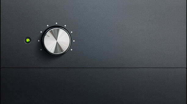 amplifier detail degrading black surface of amplifier with one knob and green warning led knob stock pictures, royalty-free photos & images