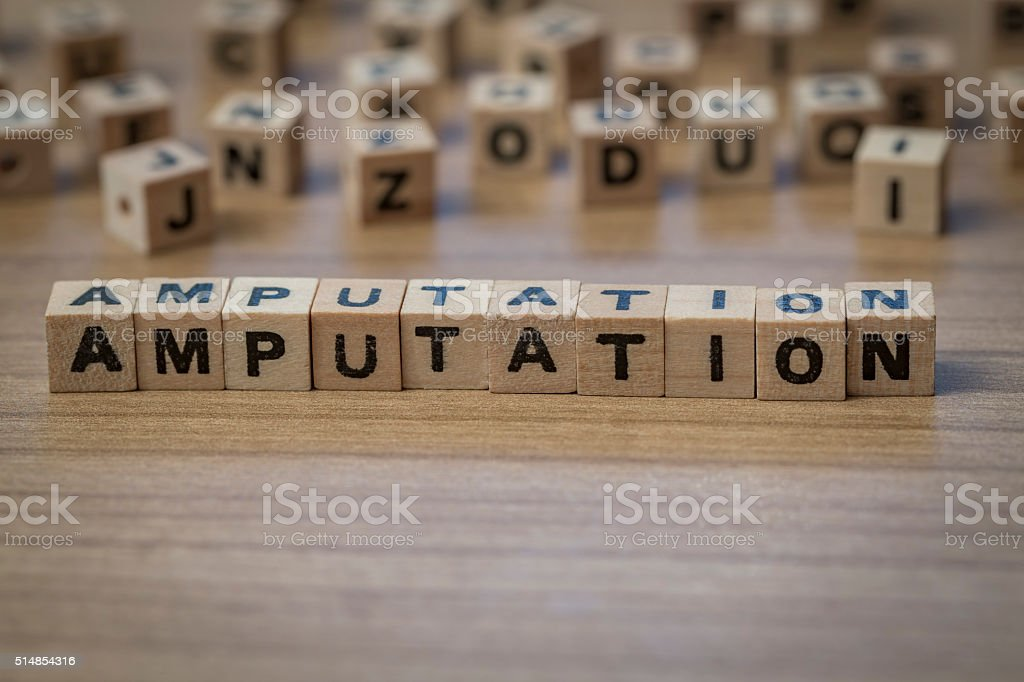 Amputation written in wooden cubes stock photo