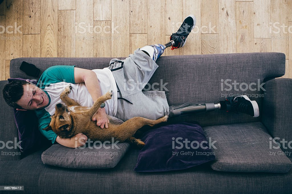Amputee and his Dog stock photo