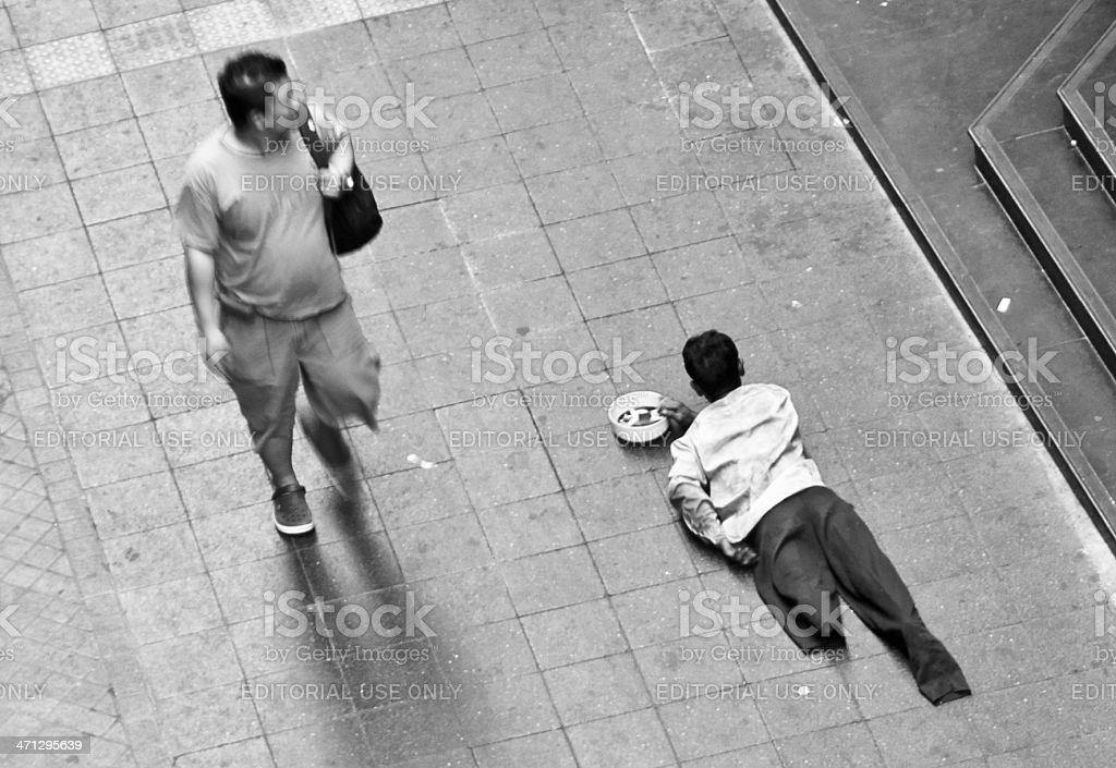 Amputee Beggar Crawling Along The Sidewalk In Bangkok royalty-free stock photo