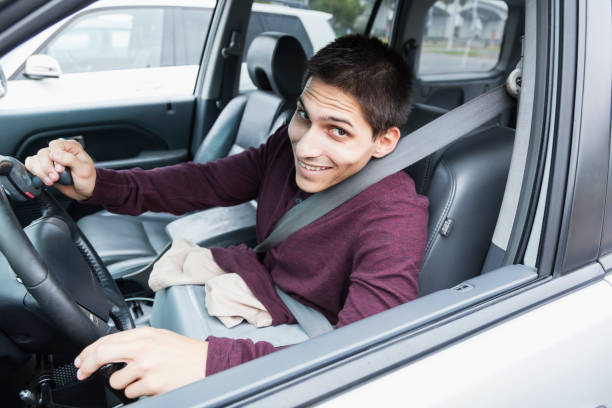 amputee driving specially equipped car - impaired driving stock photos and pictures