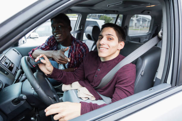 amputee driving specially equipped car, with friend - impaired driving stock photos and pictures
