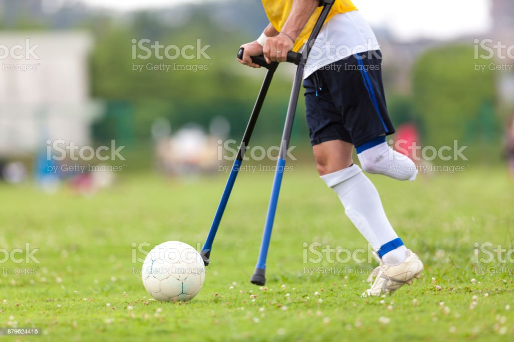 Amputee Soccer Player Kicking The Ball stock photo