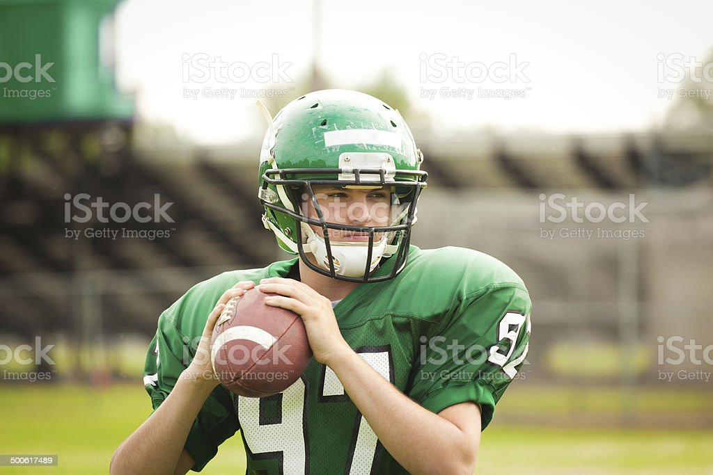 Amrtican Football Player Quarterback Throwing a Pass Close-up stock photo