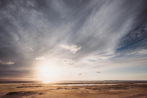 Beachchairs on the beach with a huge sky of Amrum