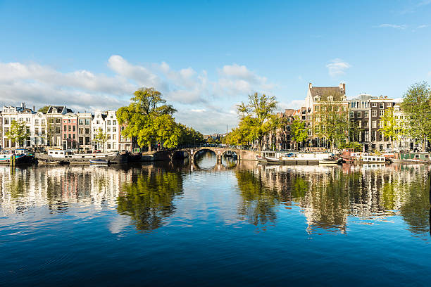 Amstel Canal Houses in Amsterdam Netherlands stock photo