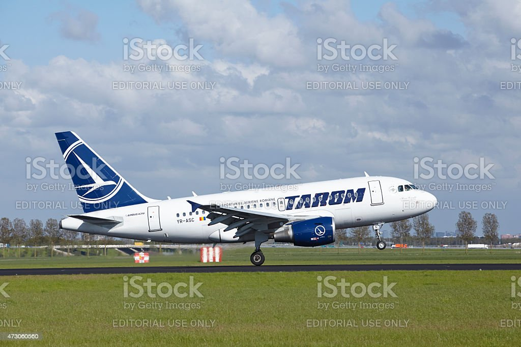 Amsterdam Airport Schiphol - Airbus A318 of Tarom lands stock photo