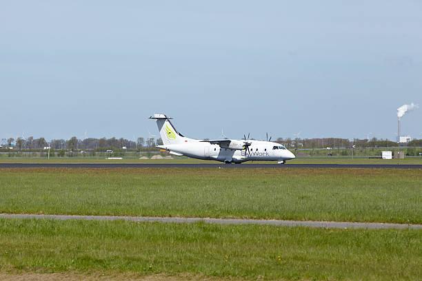 Amsterdam Airport Schiphol-Dornier 328 Von SkyWork Airlines landet – Foto