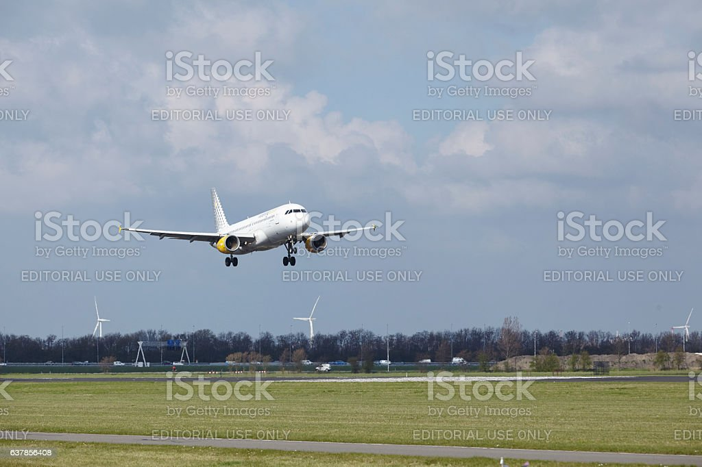Amsterdam Airport Schiphol - Vueling Airbus A320 lands stock photo